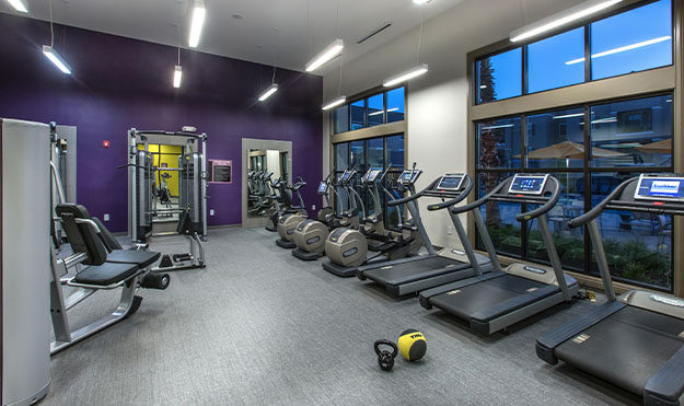 24-Hour Fitness Center With Locker Rooms, Premium Equipment, Free Weights & Spin Room